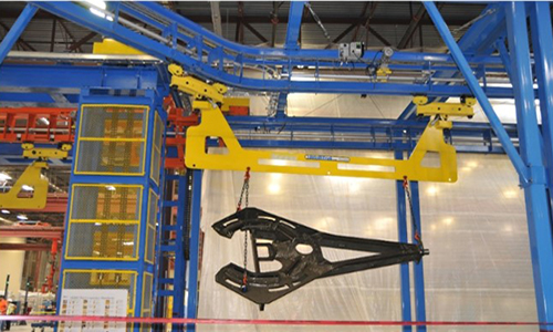 IntelliTrak 3500 Heavy Industrial Overhead Conveyor Motor Grader Finishing Line with unfinished parts