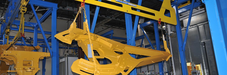 Motor Grader Finishing Line - IntelliTrak 3500 Series Overhead Conveyor