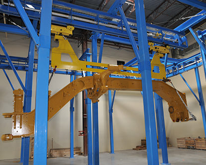 Motor Grader Finishing Line - IntelliTrak 3500 Series Overhead Conveyor
