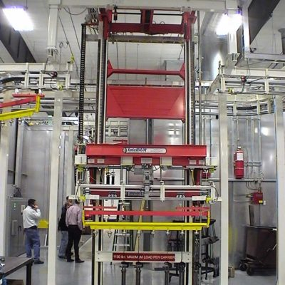 Hydraulic Cylinder Finishing Line with Two Post Cantilever Vertical Lift - IntelliTrak 500 Series Overhead Conveyor