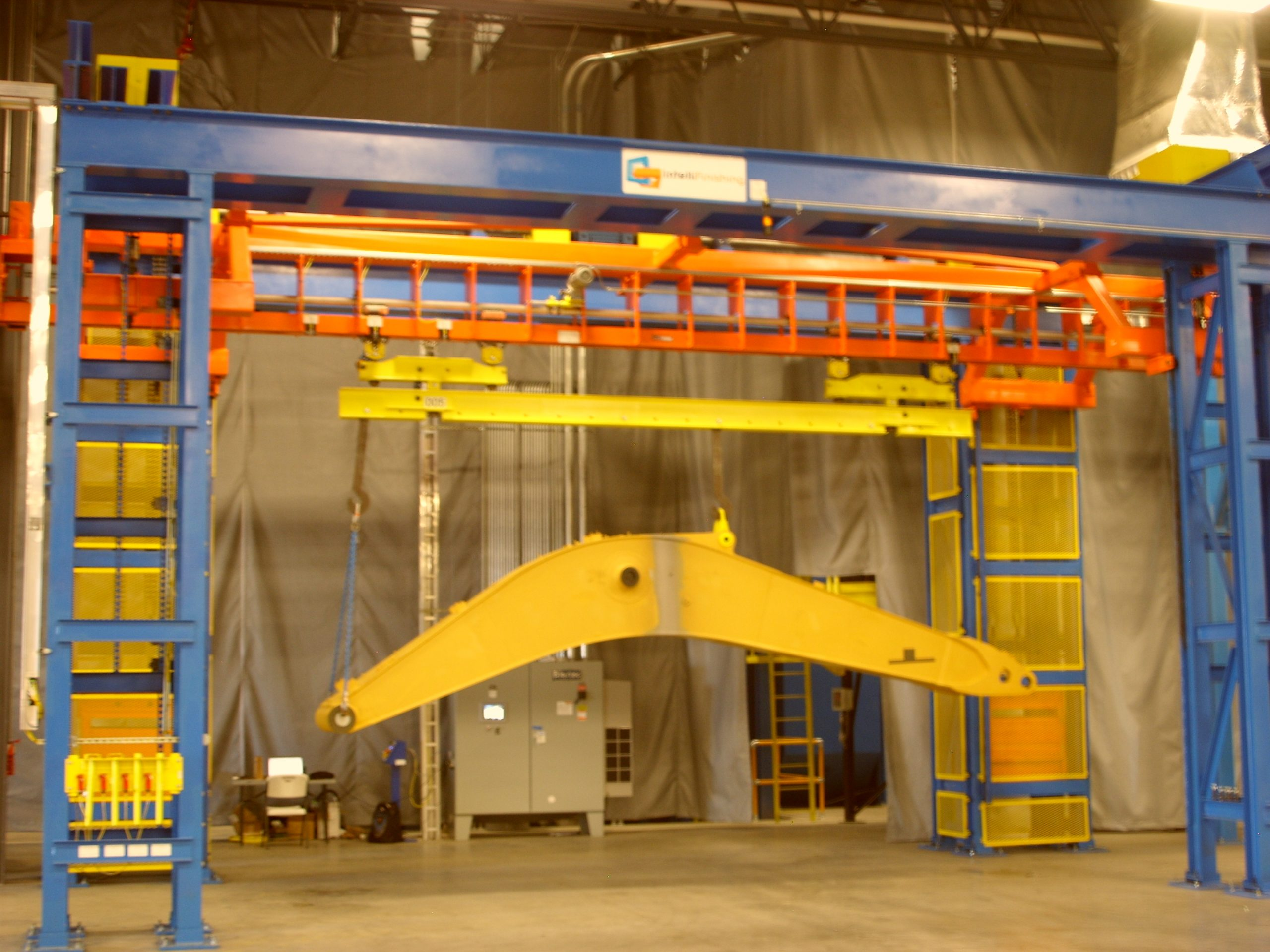 IntelliTrak 3500 Series Overhead Conveyor - Excavator Boom and Stick Finishing Line