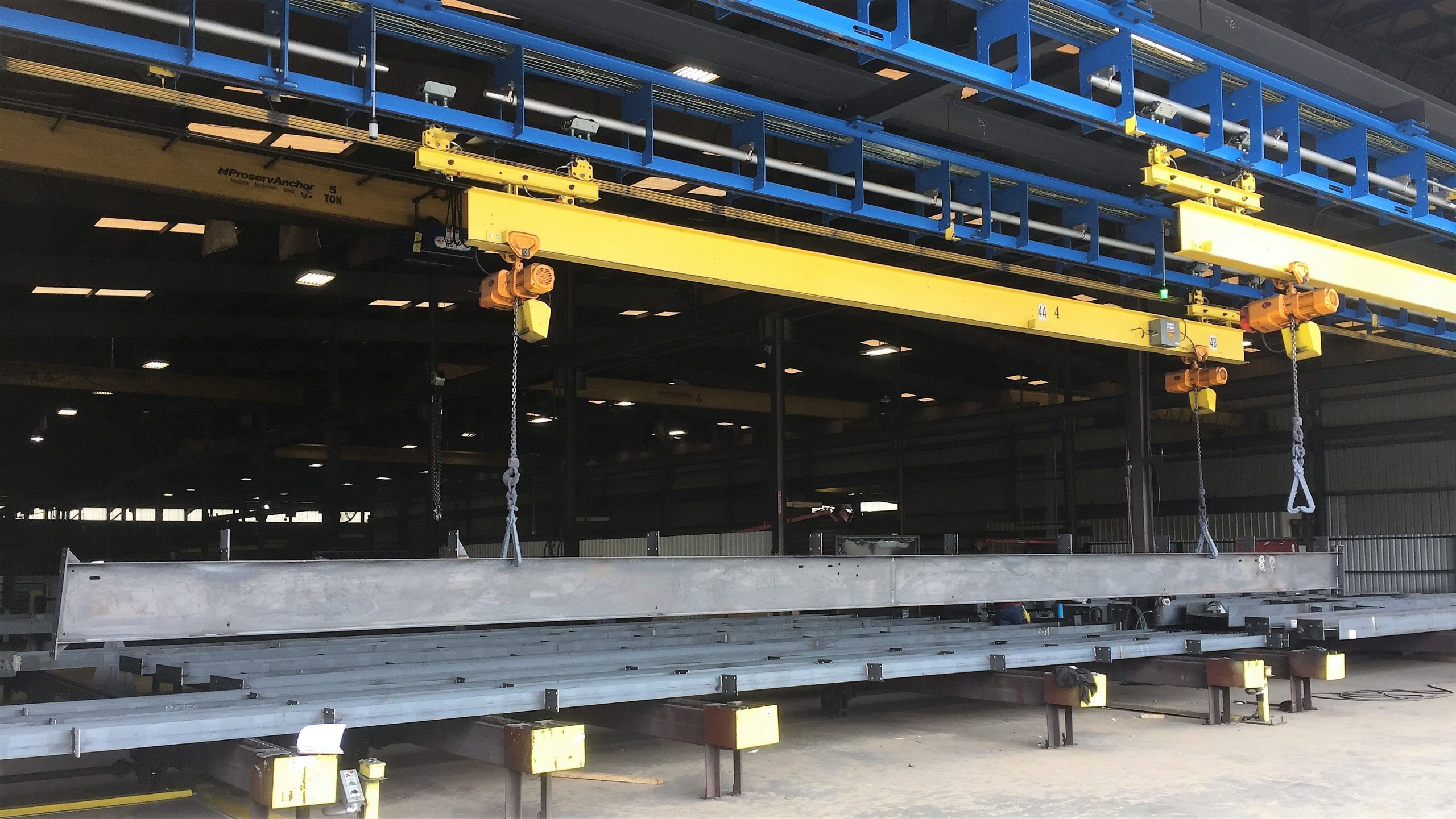 IntelliTrak 1500 Series Overhead Conveyor - Building Structure Finishing Line