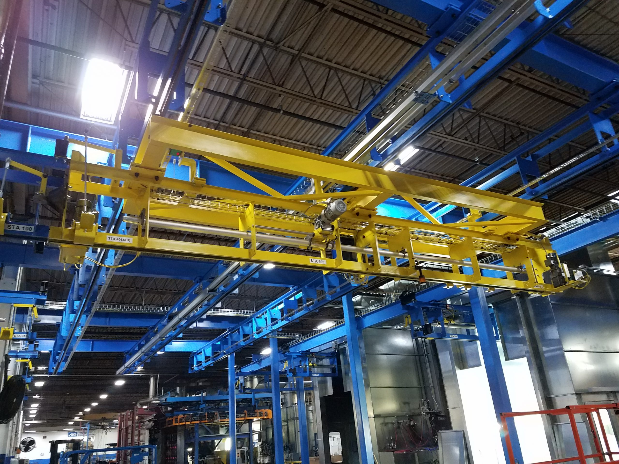 Lift Truck Attachments Finishing Line with Shuttle - IntelliTrak 1500 Overhead Conveyor