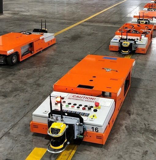 Automated Guided Cart following magnetic tape path in warehouse